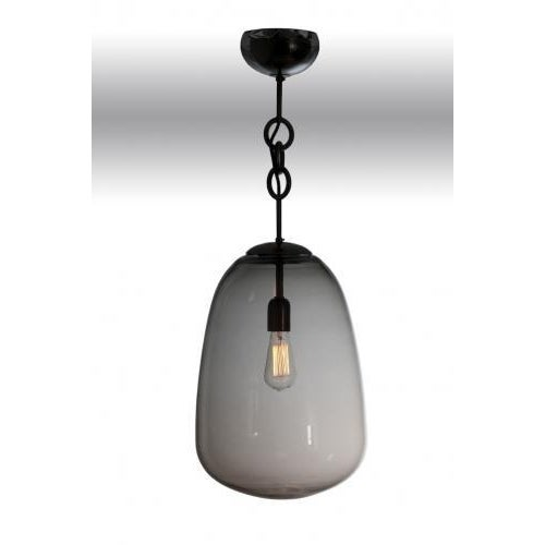 The Matteo Lantern by Seguso for Van den Akker features a hand blown glass shade and ceiling cup and rubbed bronze...