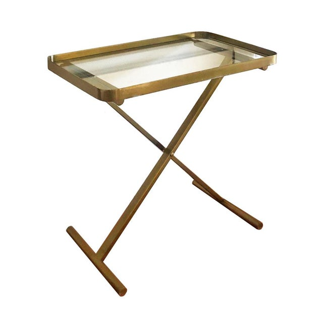 Brass tray with clear glass on cross braced stand by designer Ralph Lauren. Tray is not removable, glass is removable....
