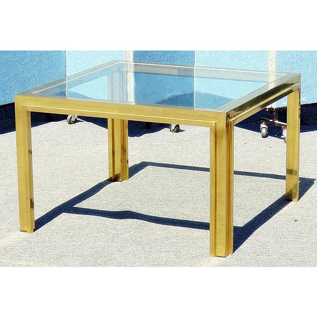 Willy Rizzo coffee table with a glass top and a brass plated frame.