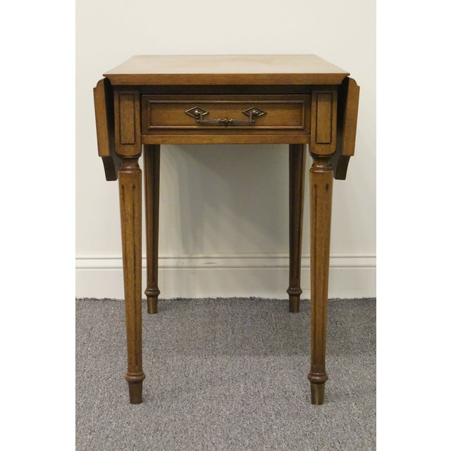 Columbia Manufacturing mahogany pembroke end table. We specialize in high end used furniture that we consider to be at...
