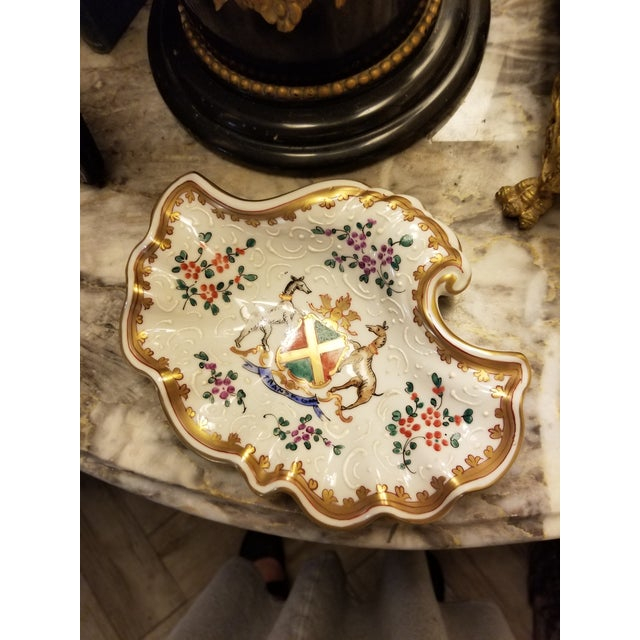 Pretty vintage Samson French porcelain shell form bowl with faux Armorial crest .