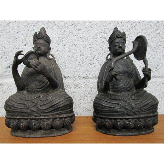 Pair of bronze buddha statues.