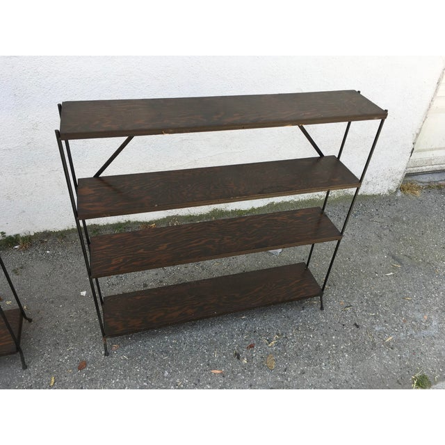 Pair of California modern iron and birch plywood (darker stain) matching low bookcases. Original condition, wood is in...