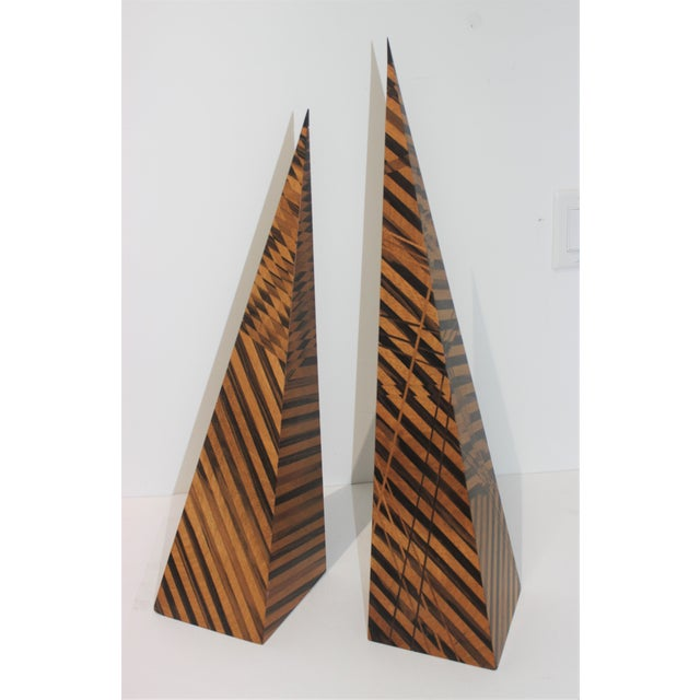 This sylish set of two artisan parquetry obelisk date to 1991 and were acquired from a Palm Beach estate. The piece are...