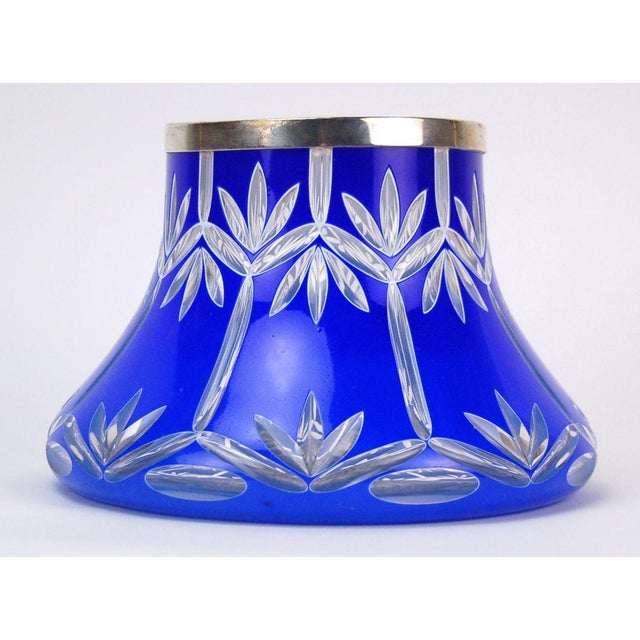 Lovely early 20th century vase made of cased glass shading from light blue to deep cobalt from bottom to top and cut...