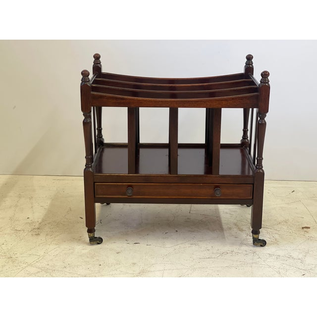 Early 20th Century English canterbury of mahogany designed in the Regency style with three divided compartments for music...