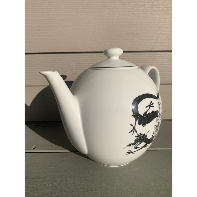 I have a delightfully fun and rare TinTin teapot. The tea pot is made by Axis-Paris and is white with black drawings on...
