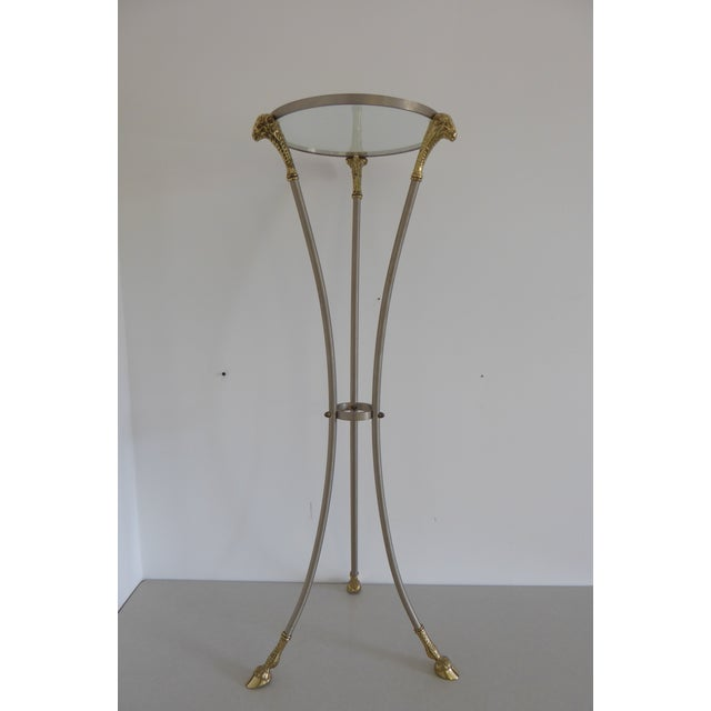 Maison Jansen brushed nickel pedestal table with solid brass detailing on the hoof feet and ram's heads. Thick glass...