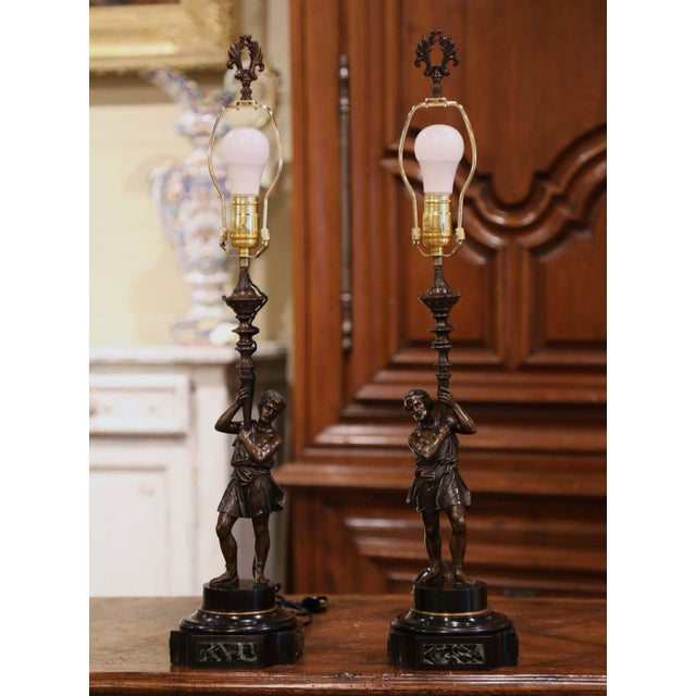 Crafted in France, circa 1860, each antique light stands on a double square and circular marble plinth base with round cut...