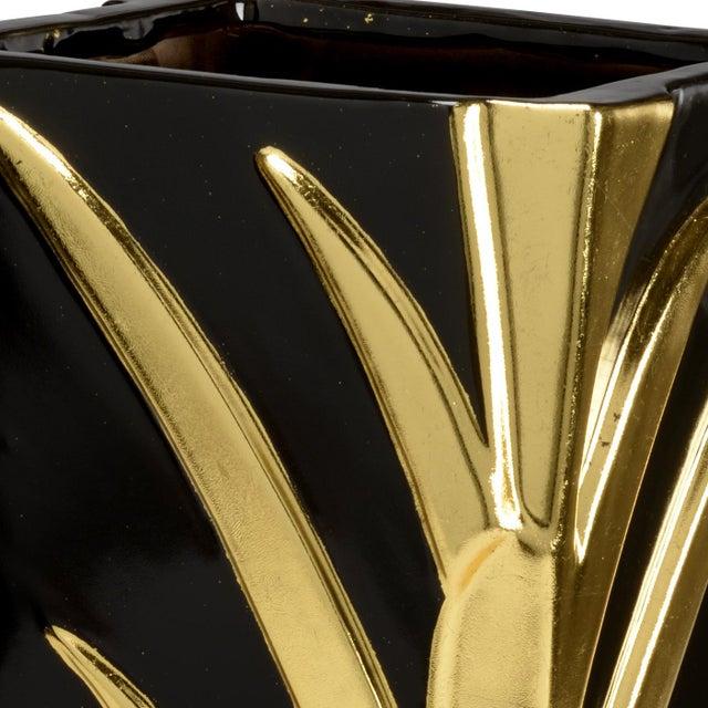 Black glaze with gold details porcelain leaf vase