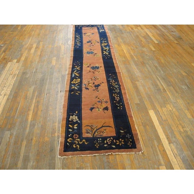 Antique Chinese Art Deco Rug with a rose pink background.