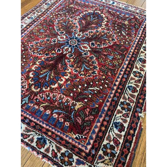 Hand Knotted Petite Persian rug in traditional color way.