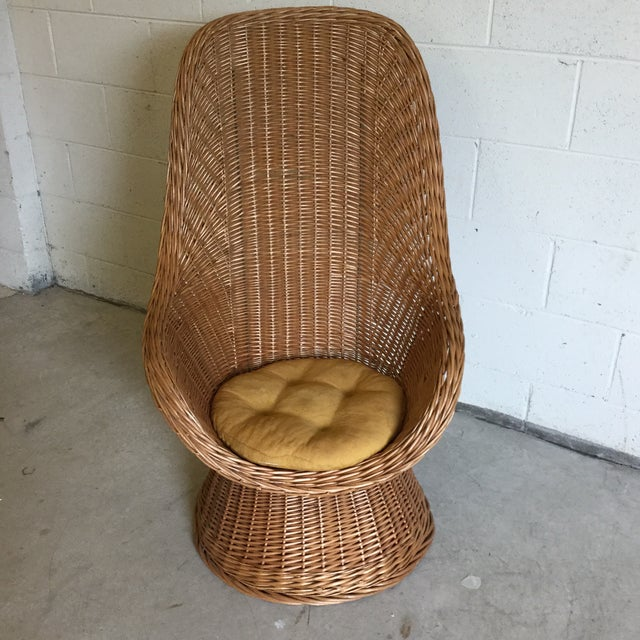 Great boho look. Excellent condition to the wicker. Cushion is stained. Tall back has metal bars wove in for a sturdy seat.