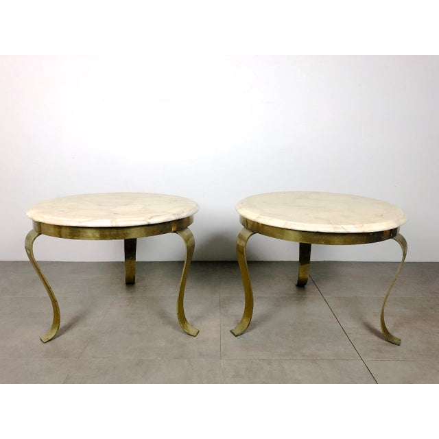 Pair of decorative modern round tables by Guy Muller for Muller's of Mexico, 1960's-70's. Sculptural ribbon-like legs in...