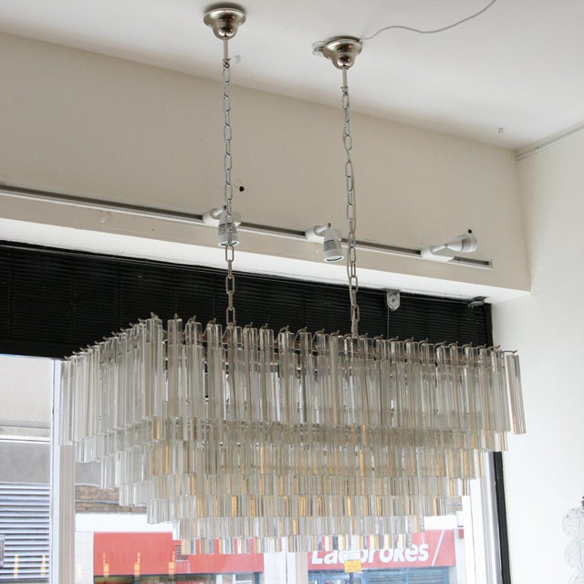 A stunning rectangular ceiling light. Clear blown Triedri glass components on chromed steel structure. Design Venini. Made...