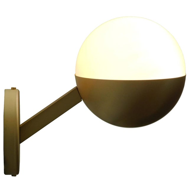 Italian modern wall light with frosted white Murano glass globe, mounted on satin brass metal finish / Designed by Fabio...