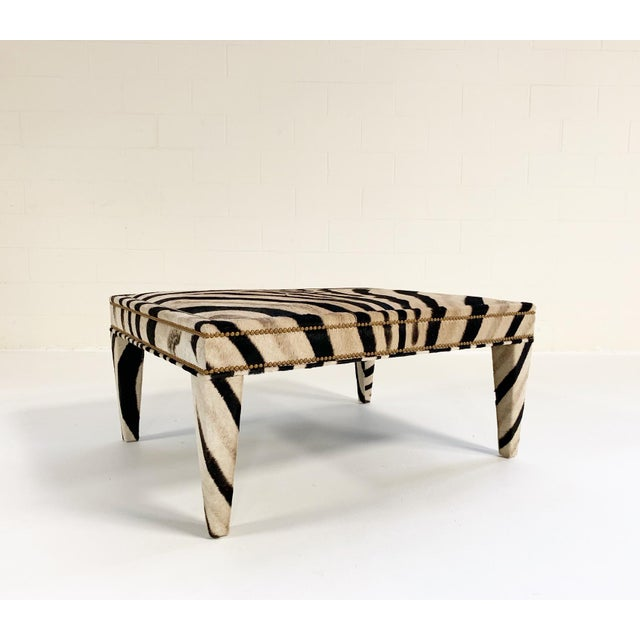 A Forsyth signature item, this zebra hide ottoman can double as a chic and elegant coffee table. Custom made to order in...