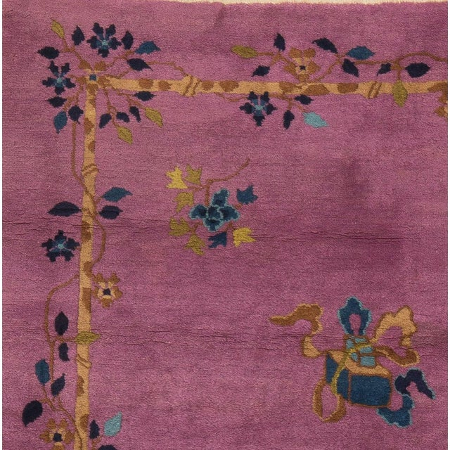 An unusual lavender ground covers the field and border of this rare square art deco rug.The field and the border are set...