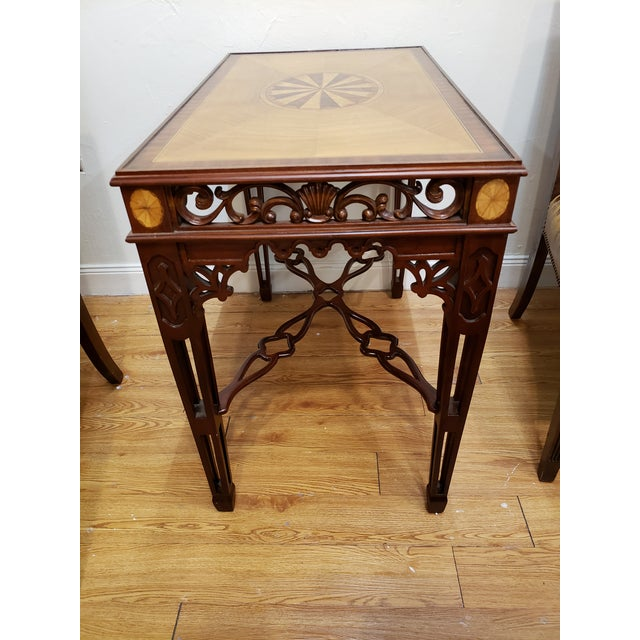 Vintage Maitland-Smith inlay tea table made in the Chinese Chippendale style. Handcrafted of solid mahogany wood. Features...