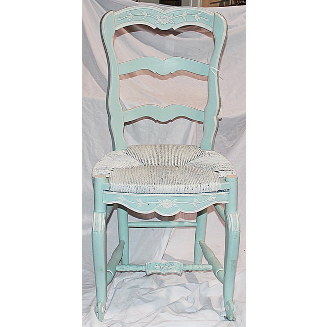 French country-style dining chair featuring a durable, rushed-seat. Recently finished in a custom Annie Sloan paint color...