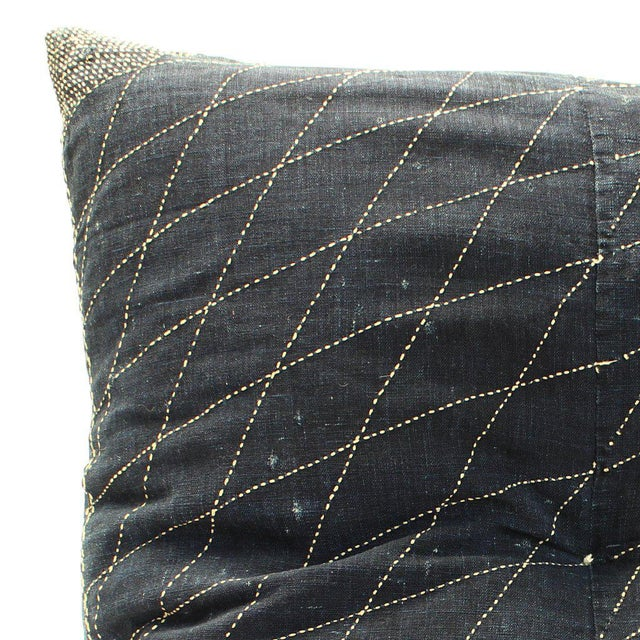 "This pillow is made from a antique indigo sashiko furoshiki and kasuri futonji. 27"" x 27"" (width, height)"