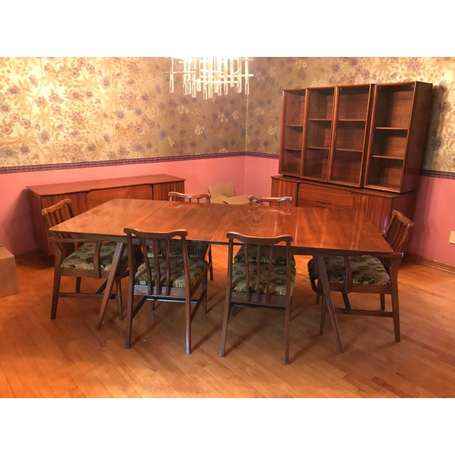 Dining room table is 96 inches in length without leaves. Each leaf is 12 inches. The width is 40 inches. Top of table has...