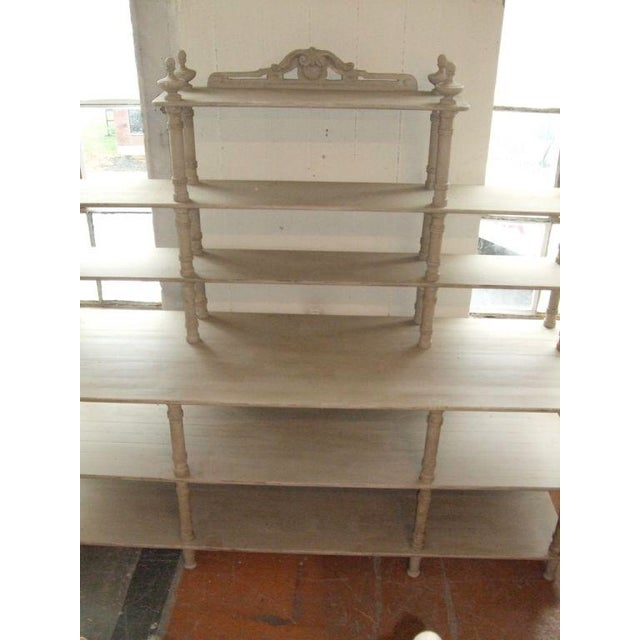 Large-scale antiqued grey painted shelving unit. Pair available, priced separately.