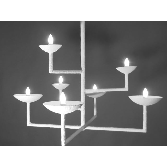 Seven cup and seven light square chandelier with L-shaped extended arms. Plaster and steel multi armed chandelier with a...