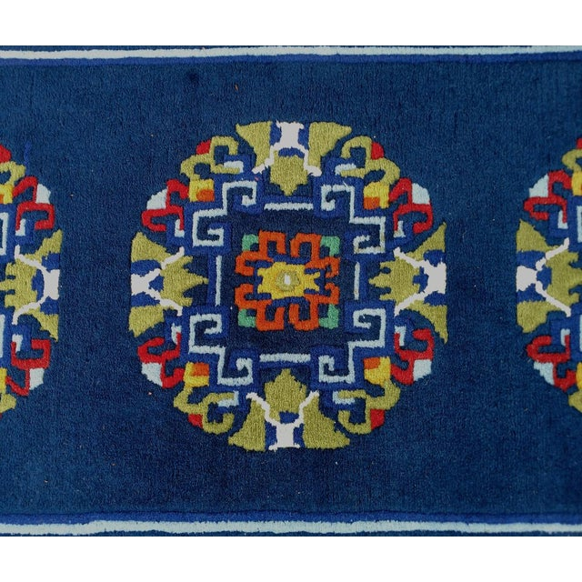 This is a beautiful hand-knotted Asian rug, with a rich navy blue background. The accent colors are, gold, sage green,...