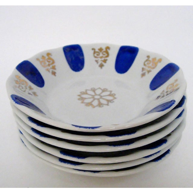 Set of 6 Turkish white porcelain dipping bowls with hand-painted cobalt accents and stamped gold designs. Maker's mark on...