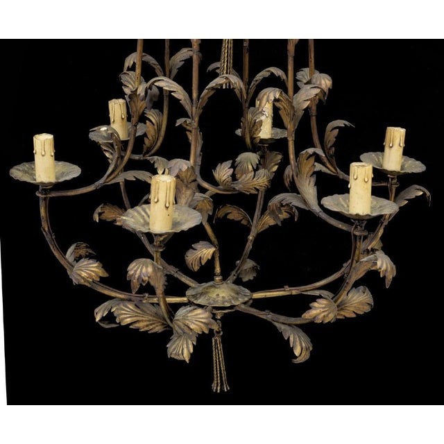 Rich antique bronze color Italian gilt metal six-light chandelier. Chandelier consists of lights within candle covers with...