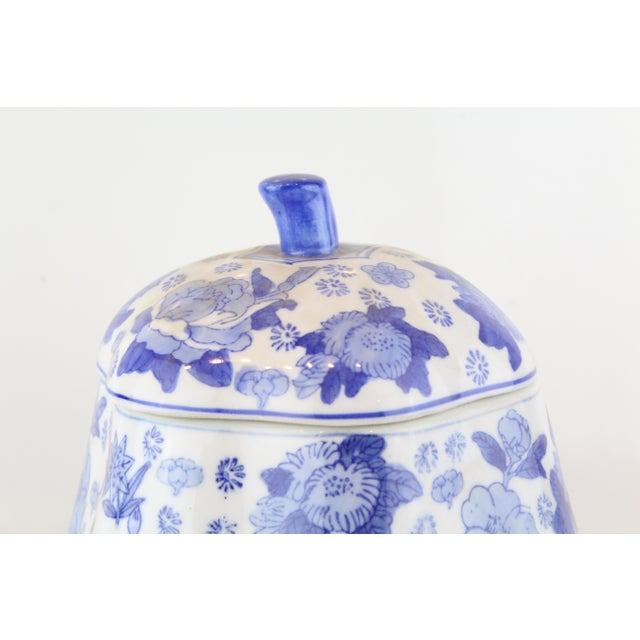 Country Chinese Canton covered jar in the shape of a gourd in blue and white floral patterned porcelain.