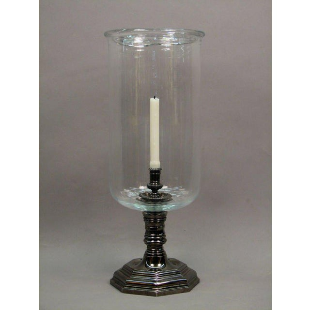 A large Louis XIV style hurricane lamp having a black nickel plated octagonal body fitted with a hand blown glass shade...
