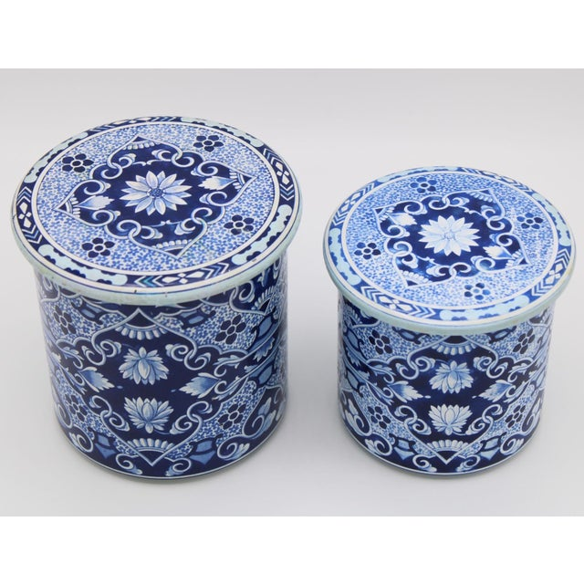 A fabulous pair of blue and white floral pattern tole canisters made in Delft Holland. These canisters are stackable. The...