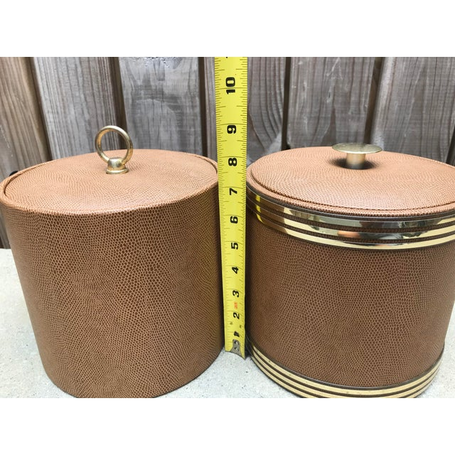 George Briard ice buckets, faux leather with gold accents. Made in the 1960s.