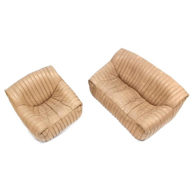 Very nice mid century modern French love seat sofa and a matching 35x36x26 lounge chair in ribbed leather upholstery.