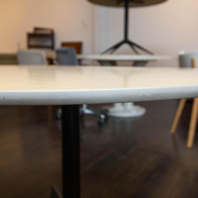 Eames design for Herman Miller Features aluminum star base and wood laminate top. Measures: 42.