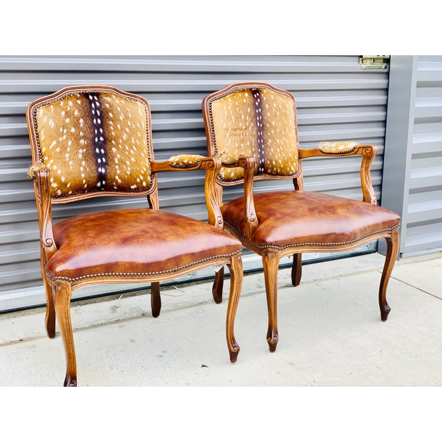 Pair of custom Axis deer arm chairs by Parker & Hyde. Italian wood frames, Axis deer on both inside and outside backs and...