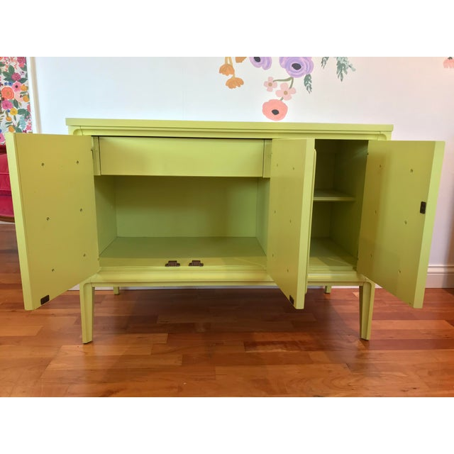 Broyhill small console great for a bedside stand or an entryway. Another option as a dry bar. Storage for stemware and...