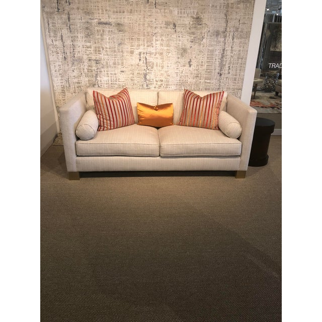 Stamford CT floor sample. Addison sofa. Upholstered in Scalamandre Spire color Nacne Block brass legs Eight way hand tied...
