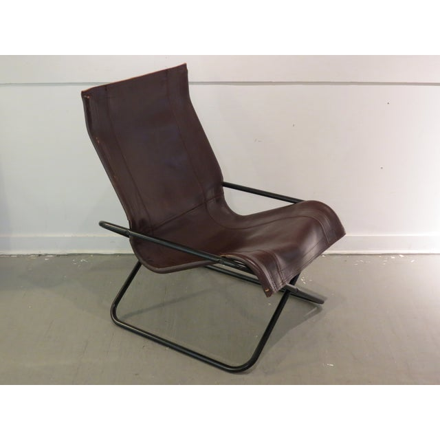 Vintage 1970's Leather sling chair by Suekichi Uchida of Japan. This handsome chair features a collapsible tubular black...
