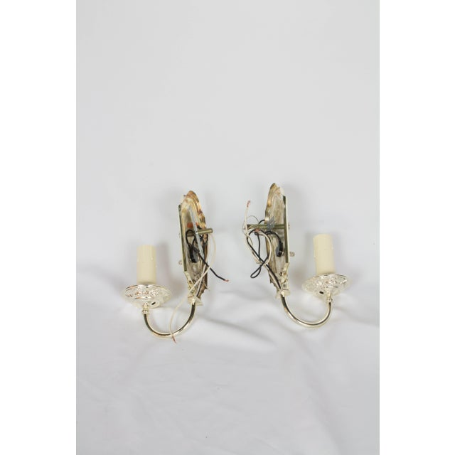 Pair of Silver Plated Sconces. Classic traditional form. Completely restored, re-plated, and rewired. With new candle...