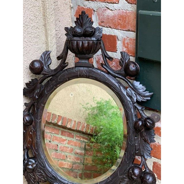 19th Century Antique English Black Forest Style Carved Dark Oak Oval Wall Mirror For Sale - Image 4 of 13