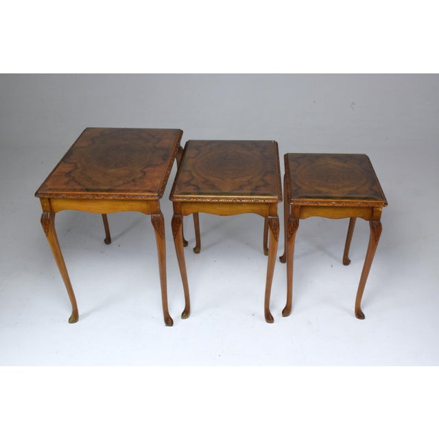 A 20th century vintage set of circassian figured walnut veneers bookmatched set of three nesting tables of 1920s Russian...