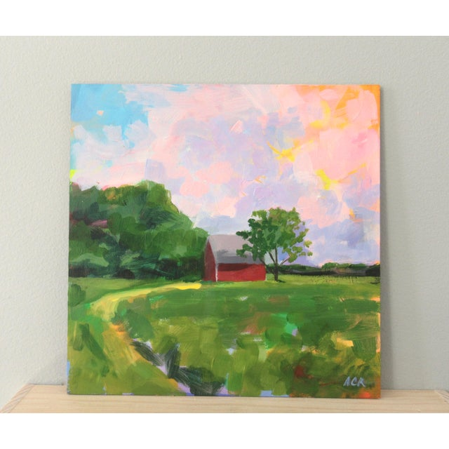 A vibrant, bright, semi-abstract, unframed painting of a red house in Vermont. A beautiful lush area with a gorgeous sky....