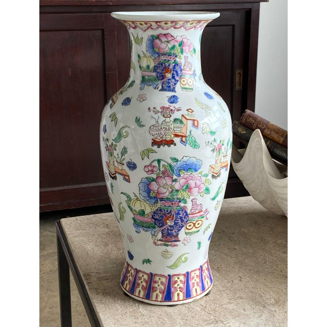 A 19th century Chinese Famille Rose vase with pink flowers, tables, vases and cats. I just love everything going on with...
