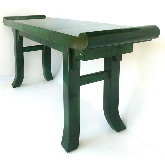 Offered for sale is an overscale stylized green goatskin altar table style console table with splayed legs. Unsigned but...