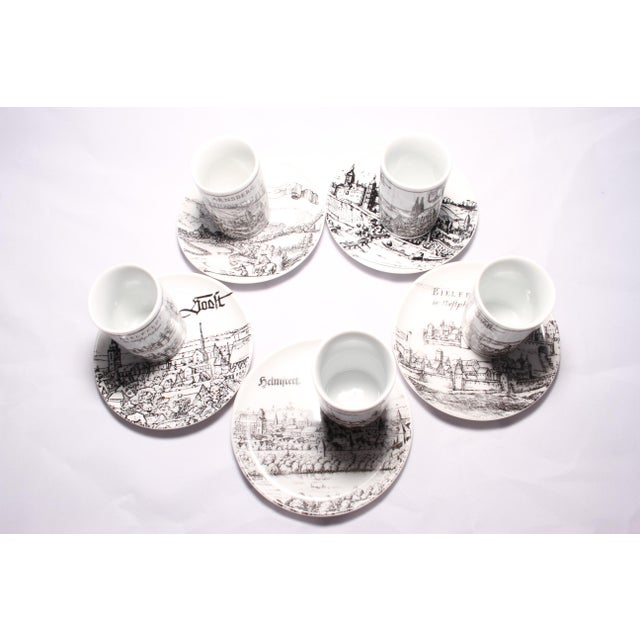 This fabulous set of five (with an extra cup) vintage black and white pen & ink porcelain cups and plates are made in...