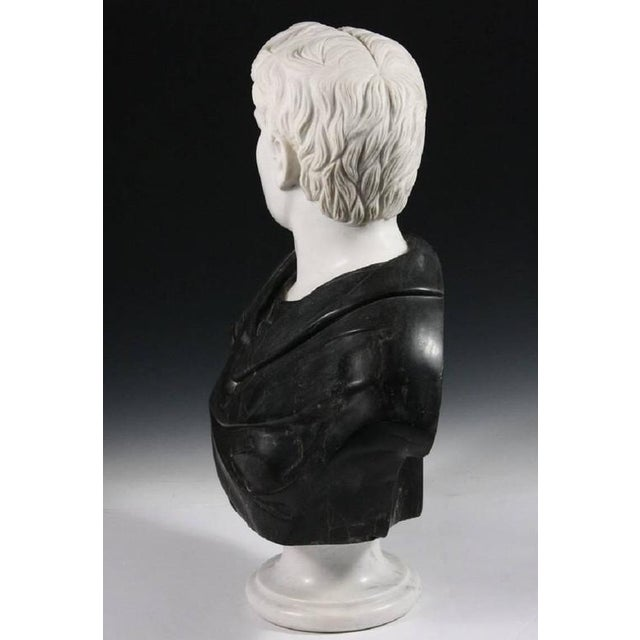 This substantial bust in striking black and white marble makes a grand impression and works well in many of today's...