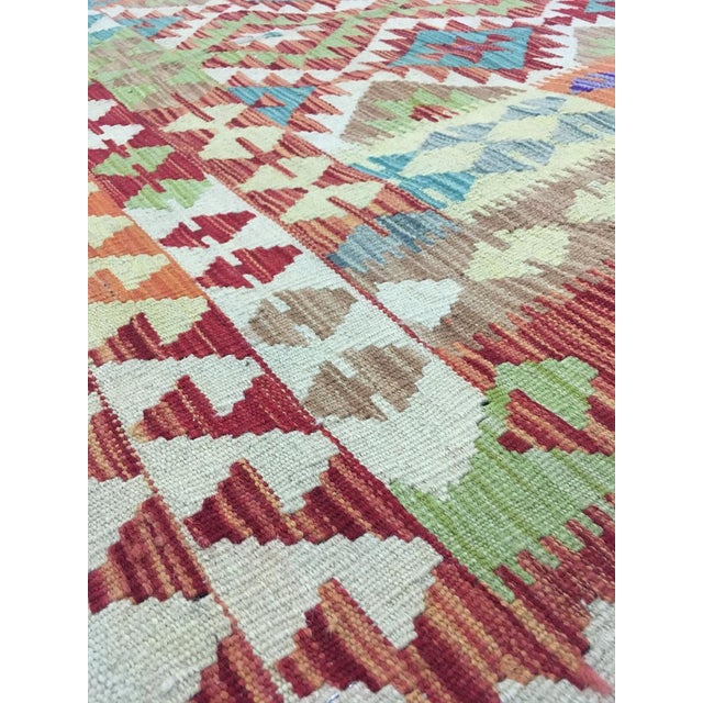 A beautiful traditional Uzbek kilim. This kilim is made of 100% wool, dyed with all natural dyes made from vegetable...